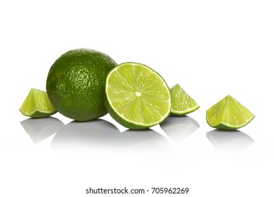 Arrangement of whole lime with slices isolated on white background