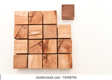 "Arrangement of the wooden blocks on a white background.""not in place"""