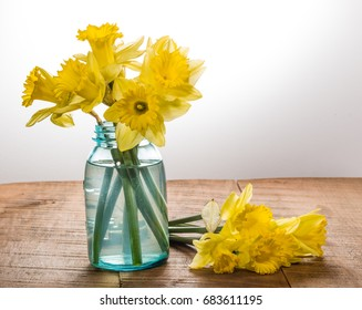 Arrangement of yellow dafodills in blue jar