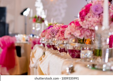 Arrangements with pink flowers on the table light side