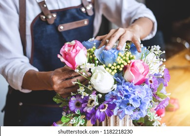 Arranging artificial flowers vest decoration at home, Young woman florist work making organizing diy artificial flower, craft and hand made concept.