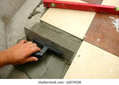 arranging  tiles on the floor
