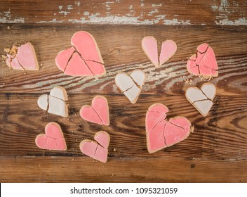 Array of Broken Heart Cookies over vintage wooden background