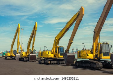 An array of Excavators at sea port