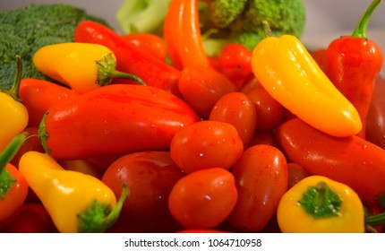 An array of fresh vegetables in different shapes and colors.