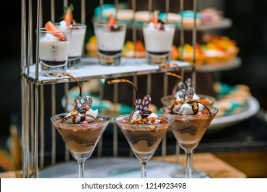 Array of homemade sweets and desserts served at pastry station on the buffet.