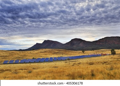 Array of on ground solar panels supplying electricity to Wilpena Pound in a middle of Flinders Ranges national park in isolation from power grid and infrastructure.