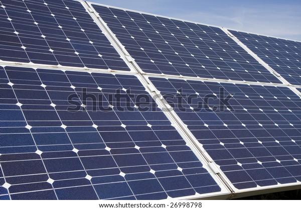 An array of photovoltaic solar panels. Alternative energy