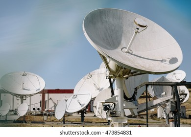 Array of satellite dishes for telecommunications