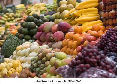 An array of tropical fruits in Ecuadorian market, South America.