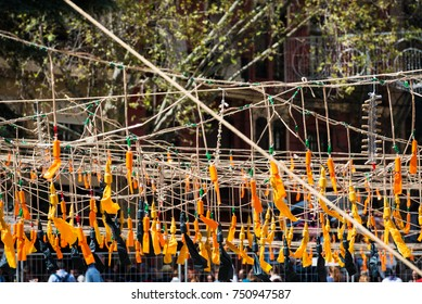 Arrays of orange firecrackers prepared for the Mascleta during the Fallas Festival in Valencia, Spain.
