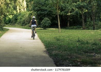 Arre, España, 09-14-2018: Female cyclist on rural road