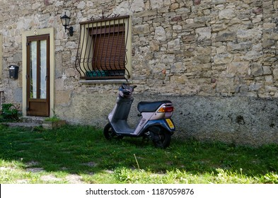 Arre, España, 21/09/2018 : motorcycle parked at the door of a house
