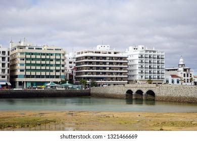 ARRECIFE, SPAIN - CIRCA FEBRUARY 2019 Buildings on the coast