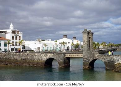 ARRECIFE, SPAIN - CIRCA FEBRUARY 2019 Bridge on the coast