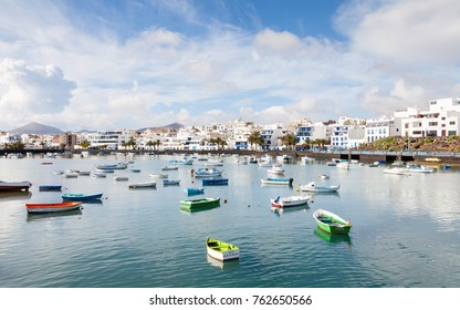 """ARRECIFE, SPAIN - NOVEMBER 6:  Fishing boats in the laguna """"Charco de San Gines"""" in Arrecife are pictured on November 6, 2016.  Arrecife is a Spanish port city on the island of Lanzarote."""