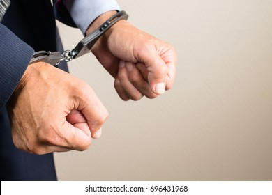 arrested businessman in handcuffs. Businessman bribetaker or briber. Concept of fraud, detention, crime and bribery