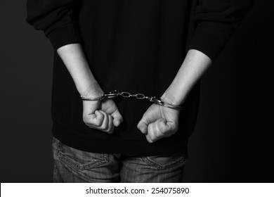 Arrested man handcuffed hands