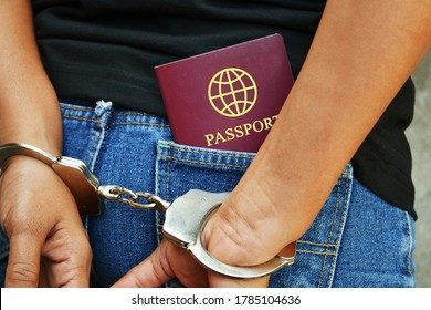Arrested person with handcuffs and a travel document in the rear pocket