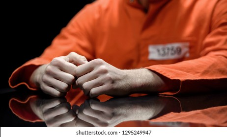 Arrested person hands closeup, prisoner talking to lawyer during interrogation