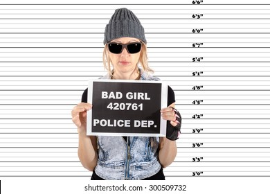 Arrested Woman posing for a mugshot, holds a signboard with bad girl notice and police department, Pure white background.