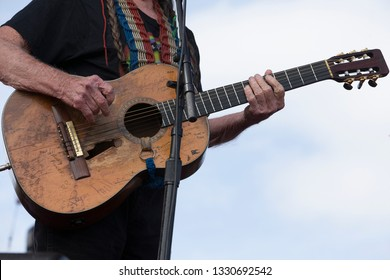 Arrington, VA/USA - 9/7/2014 : Close-up view of Trigger, Willie Nelson's guitar, at LOCKN' Festival. The guitar is named after Roy Rogers' horse and has a hole from decades of pick strumming.