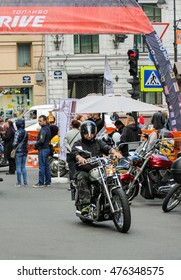 Arriving at a biker festival. St. Petersburg, Russia - 13 August, 2016. The annual International Festival of Motor Harley Davidson in St. Petersburg Ostrovsky Square.