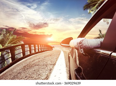 arriving on car to the hot tropical beach