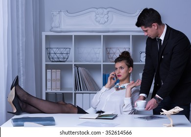 Arrogant business woman with legs on the desk