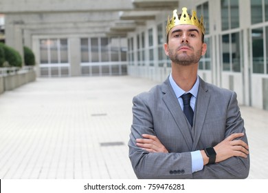 Arrogant businessman with a crown in office space