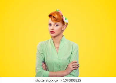 Arrogant. Closeup portrait beautiful businesswoman looking with arrogance at camera arms crossed, folded isolated yellow background wall.  Pinup girl retro vintage 50s style. Negative face expression