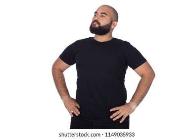 Arrogant man standing hands on waist looking up in a black outfit isolated on a white background.