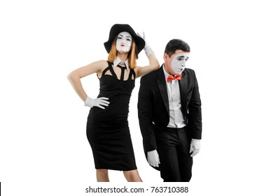 Arrogant woman and sad man. Female mime henpecks her mate, leans on his shoulder and oppresses him. Matriarchic relationship.