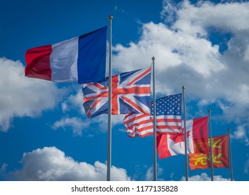 Arromanches, France - 08 13 2018: Five  Flags of freedom from Arromanches cliffs