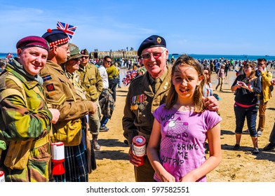 ARROMANCHES, FRANCE - JUNE 06, 2014: High dynamic range (HDR) People attending the D-Day celebrations of WW2 in Normandy