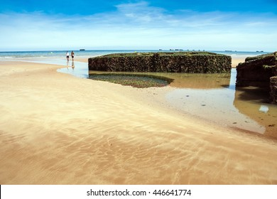 Arromanches les Bains beach with the remains of the Mulberry harbour in Normandy France, Europe