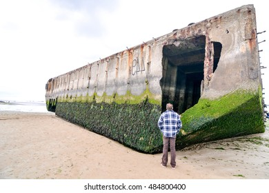 Arromanches les Bains beach with the remains of the Mulberry harbour in Normandy France Europe