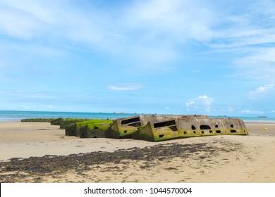 Arromanches les Bains, Normandy, France - 1 September 2017 - Concrete block, remains of Mulberry Artificial Harbor, World War II, Arromanches, Normandy, France