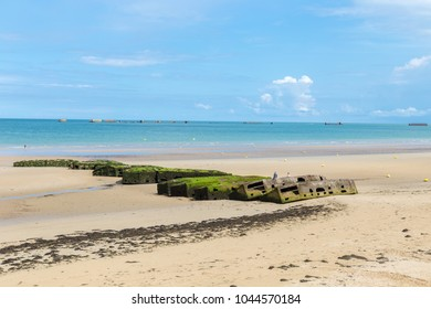 Arromanches les Bains, Normandy, France - 1 September 2017 - View over the thick concrete wall D-day beaches at Arromanches les Bains, Normandy, France