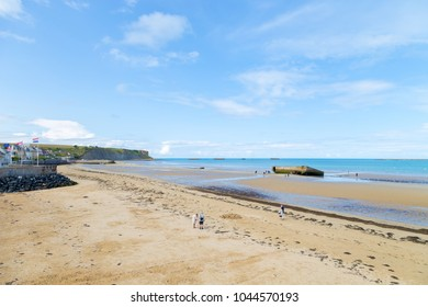 Arromanches les Bains, Normandy, France - 1 September 2017 - View over the concrete wall D-day beaches at Gold Beach Arromanches les Bains, Normandy, France