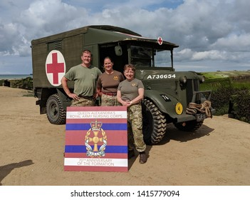Arromanches, Normandy, France, June 04 2019. Veteran nurses of 207 Field Hospital, Manchester, UK on Gold beach at Arromanches with a Field Ambulance from the North West Museum of Transport that was p