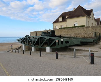 Arromanches, Normandy / France - May 3rd 2019: Ponton section of a bailey bridge from times of WW2 D-day landings, now ashore next to museum