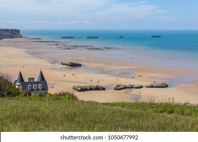 Arromanches-les-Bains beach with the remains of the Mulberry harbour in Normandy, France