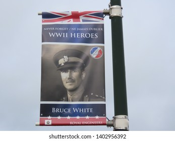 Arromanches-les-Bains, Normandy / France - 05/03/2019: Just one of many posters in memory of D-Day landings WW2 heroes. Every one is personalised. French text translated in English on poster