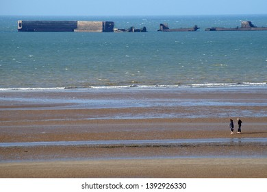 Arromanches-les-Bains, Normandy/France - September 11th, 2014: Rests form Mulberry harbour on Goldbay in Arromanches les Bains, Normandy - France from D-day invasion
