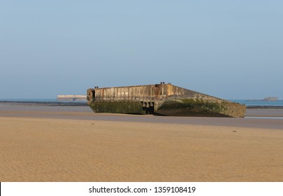 Arromanches-les-Bains,Normandy, France, March,27, 2019, Remains of the Mulberry Harbour build by the  allies in June 1944 as seen on the beach today