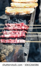 Arrosticini and bread on the grill, Abruzzi skewers of sheep cooked on the grate and on a special brazier.