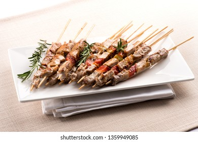 Arrosticini, or lamb skewers cooked over a canala brazier, from the Abruzzo region of Southern Italy served on a plate on a folded napkin