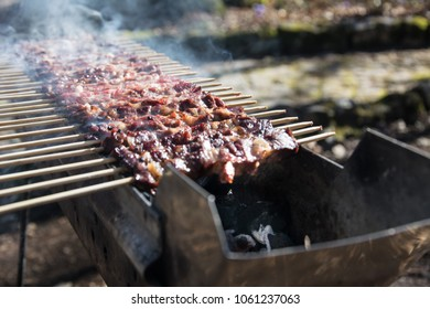 Arrosticini on the grill, Abruzzi skewers of sheep cooked on the grate and on a special brazier.