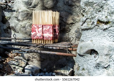 Arrosticini on the grill vertical cooking, Abruzzi skewers of sheep.